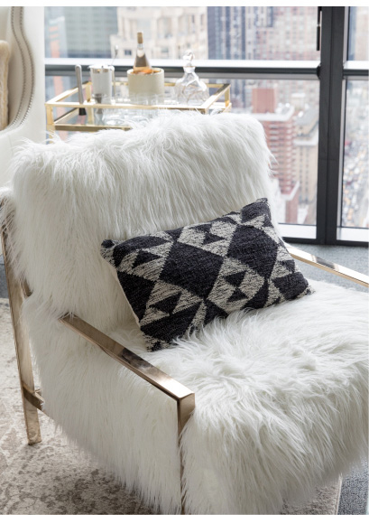 The Axel Fur Chair and the City Pillow